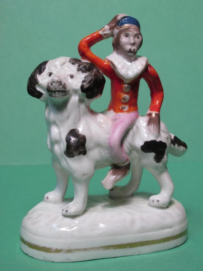 19TH C STAFFORDSHIRE MONKEY RIDING DOG