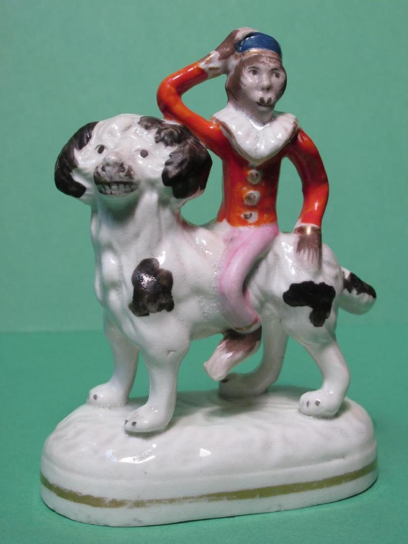 19TH C STAFFORDSHIRE MONKEY RIDING DOG