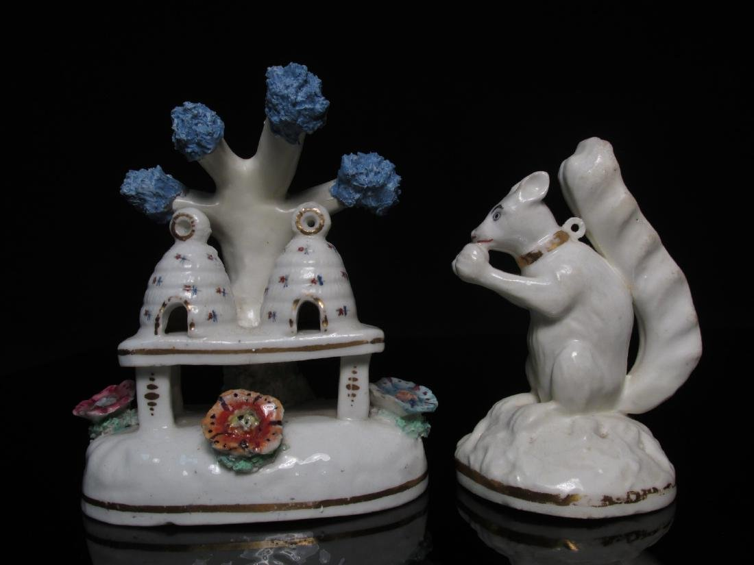TWO STAFFORDSHIRE FIGURINES DBL BEEHIVE & SQUIRREL