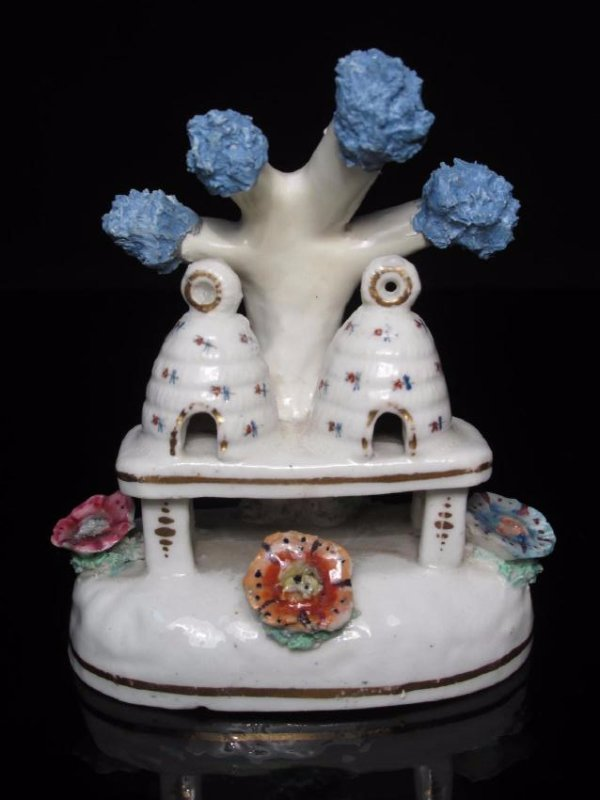 TWO STAFFORDSHIRE FIGURINES DBL BEEHIVE & SQUIRREL - 2