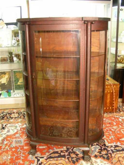 - 362: ANTIQUE OAK CURVED GLASS CHINA CABINET CLAW FOOT