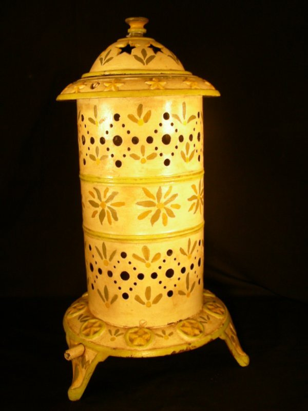 402: SMALL DECORATED ANTIQUE CAST IRON GAS HEATER