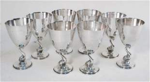 EIGHT STERLING SILVER DOLPHIN FORM GOBLETS