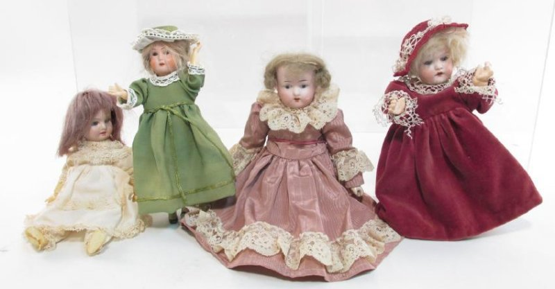 FOUR VINTAGE GERMAN PORCELAIN HEAD DOLLS