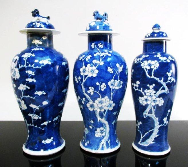 THREE CHINESE QING DYNASTY PORCELAIN PRUNUS VASES