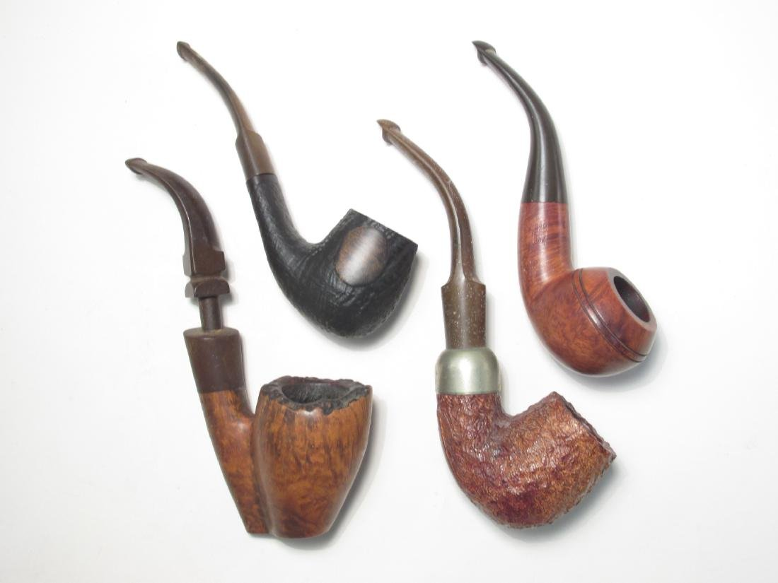FOUR RARE VINTAGE TOBACCO PIPES: PETERSONS, WADE