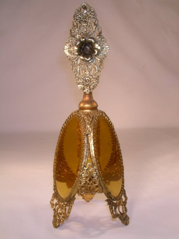 502: LARGE FOOTED BRASS FILIGREE AMBER GLASS COLOGNE