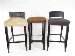 THREE ASSORTED BLACK WOODEN BAR STOOLS