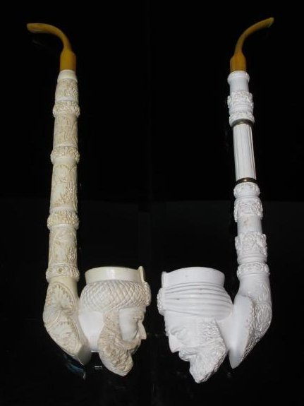 TWO LARGE CARVED MEERSCHAUM SAXOPHONE STYLE PIPES