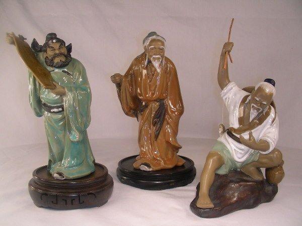8: THREE CHINESE POTTERY MUD MAN FIGURES