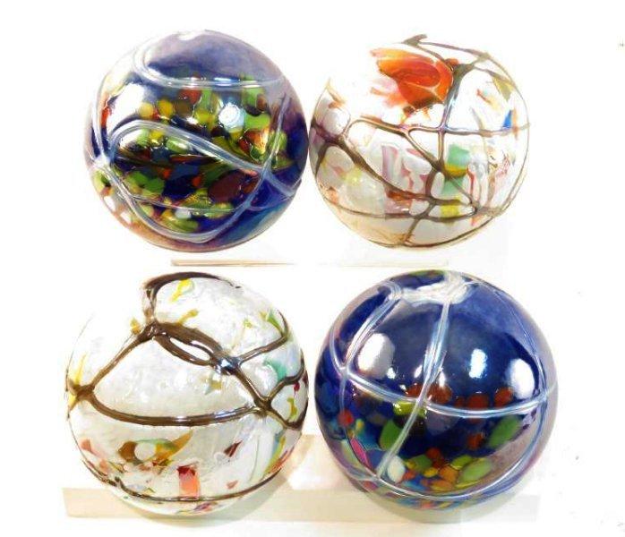 FOUR ART GLASS ORBS / SPHERES