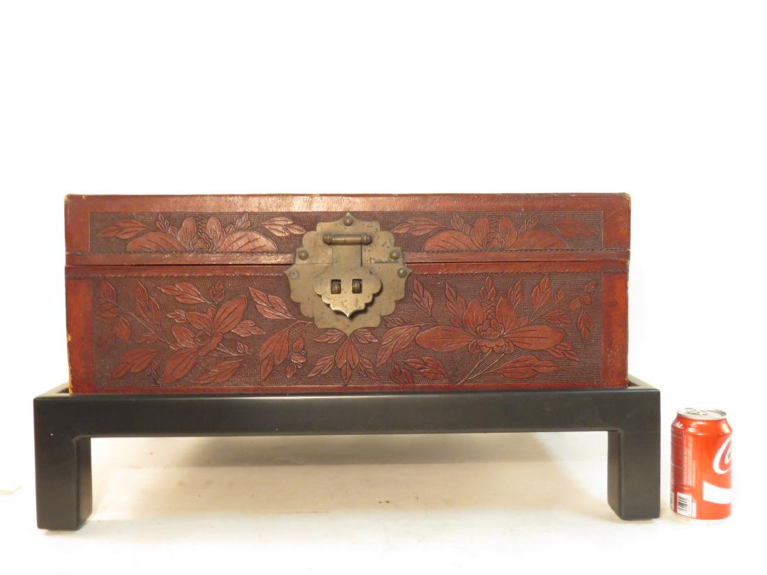 VINTAGE CHINESE EMBOSSED LEATHER CHEST ON LEGS