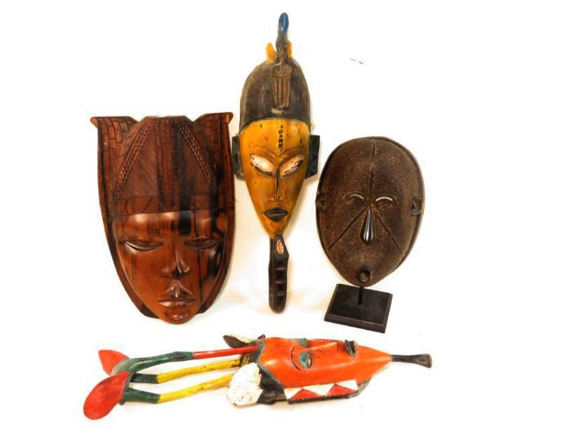 FOUR AFRICAN MASKS: ONE ON STAND