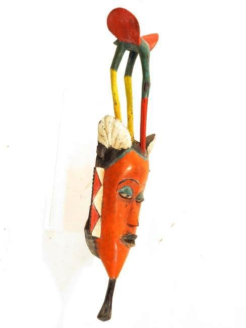 FOUR AFRICAN MASKS: ONE ON STAND - 5
