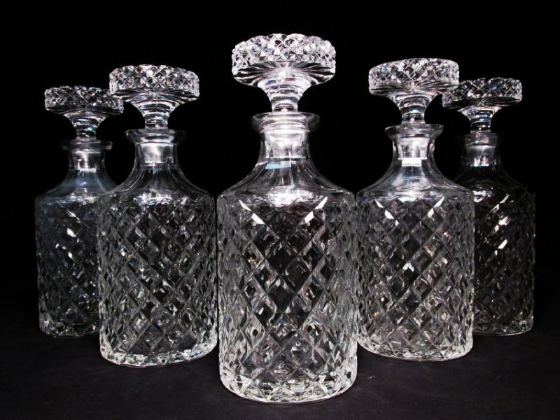 FIVE FRENCH CRISTAL D'ALBRET CUT CRYSTAL DECANTERS