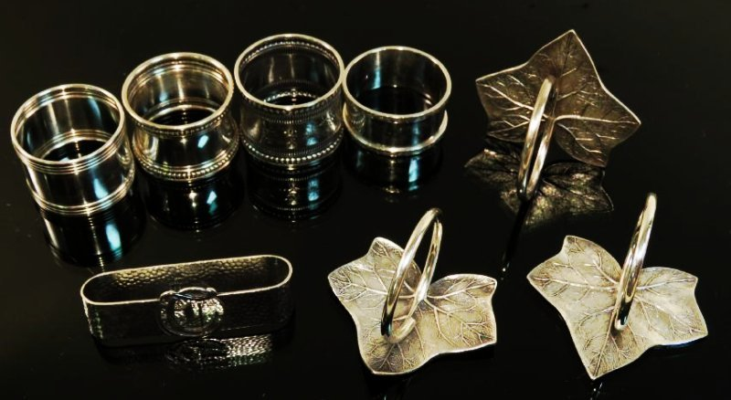 EIGHT ASSORTED STERLING SILVER NAPKIN RINGS