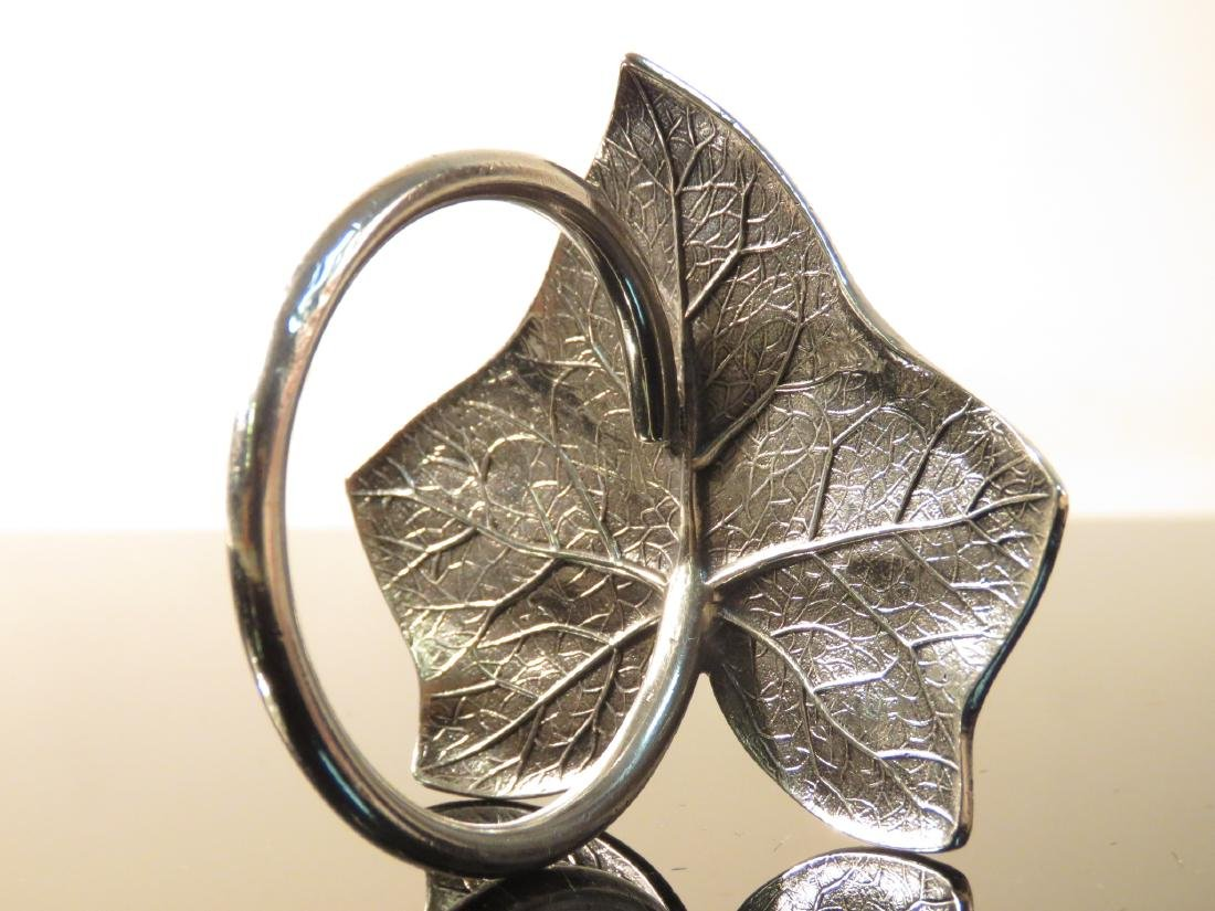 EIGHT ASSORTED STERLING SILVER NAPKIN RINGS - 6