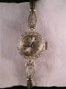 230: 14 KT WHITE GOLD ROLEX DIAMOND LADIES WATCH