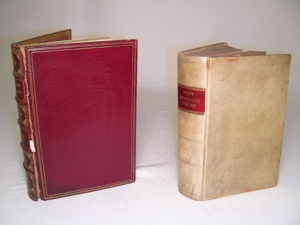 606: TWO ANTIQUE LEATHER BOOKS ROME & BABY BALLADS