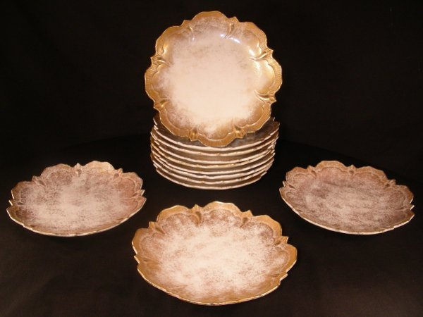 616: TWELVE FANCY GILT DECORATED PORCELAIN SIDE PLATES