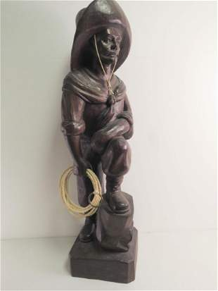 SOLID CARVED WOOD SCULPTURE OF A RANGLER