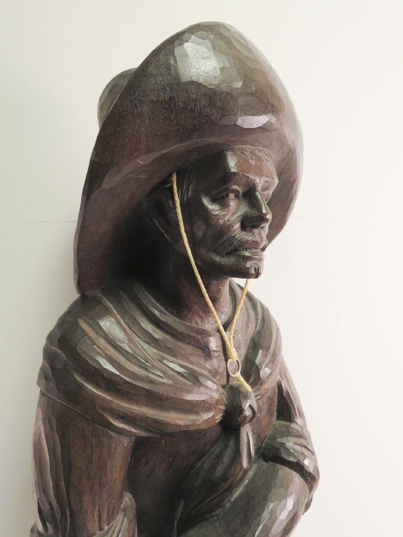 SOLID CARVED WOOD SCULPTURE OF A RANGLER - 2