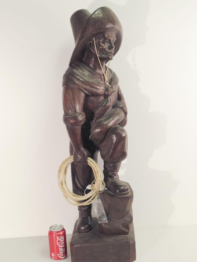 SOLID CARVED WOOD SCULPTURE OF A RANGLER - 8
