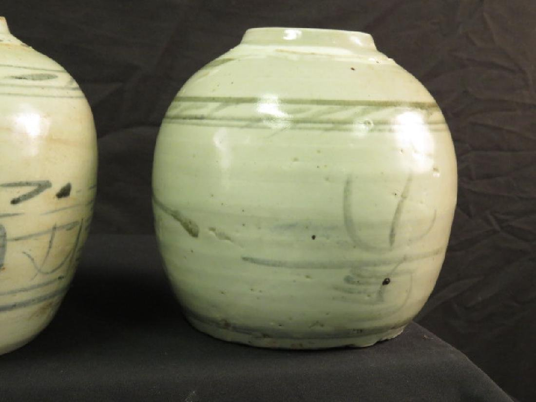 TWO ASIAN HAND THROWN POTTERY VASES OR JARS - 10