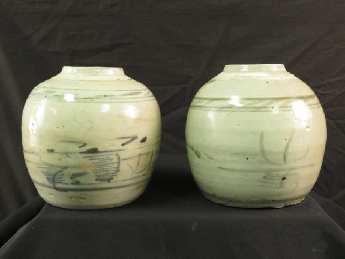 TWO ASIAN HAND THROWN POTTERY VASES OR JARS