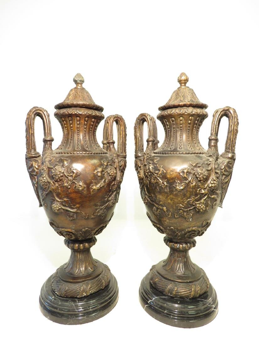 PAIR BRONZE & MARBLE COVERED URNS