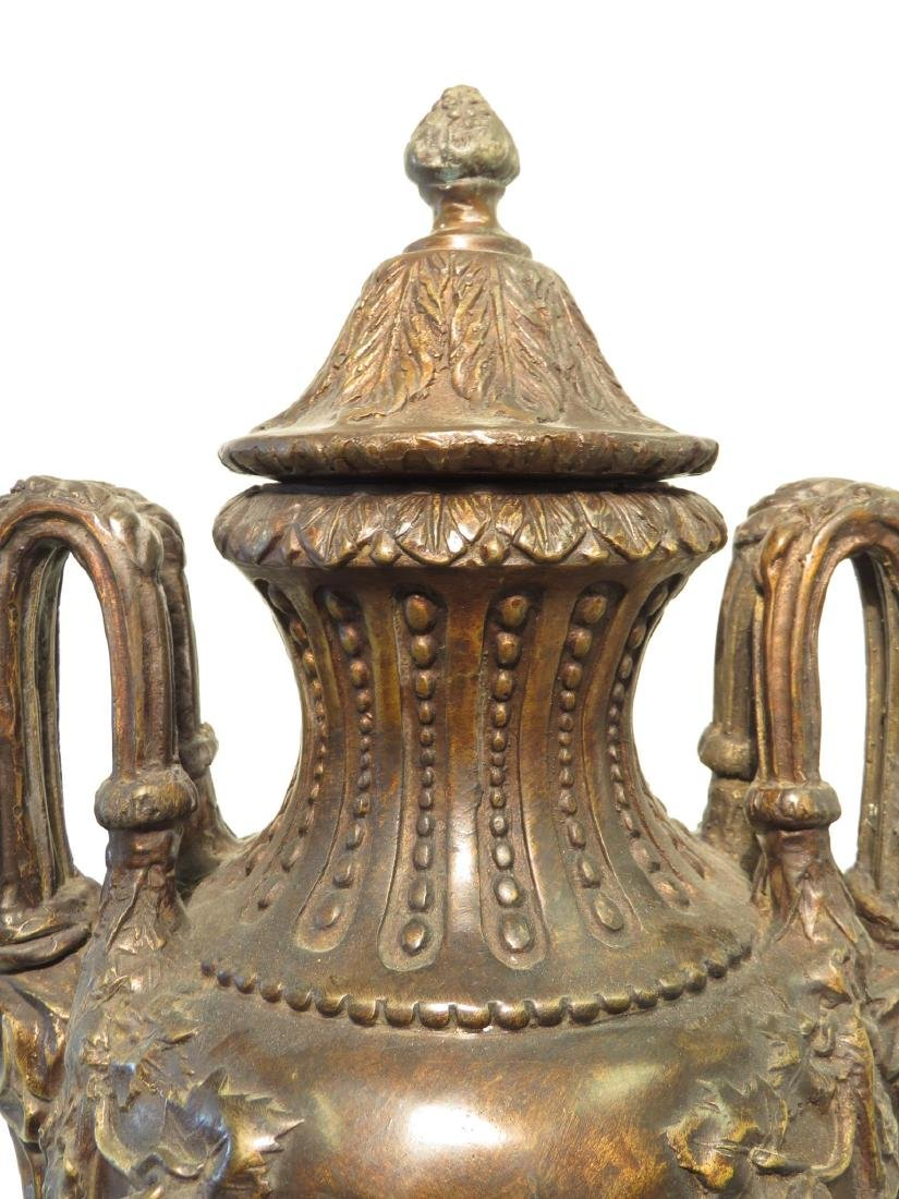 PAIR BRONZE & MARBLE COVERED URNS - 2