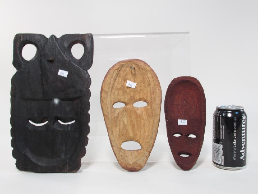 FIVE TRIBAL STYLE CARVED WOOD MASKS - 10