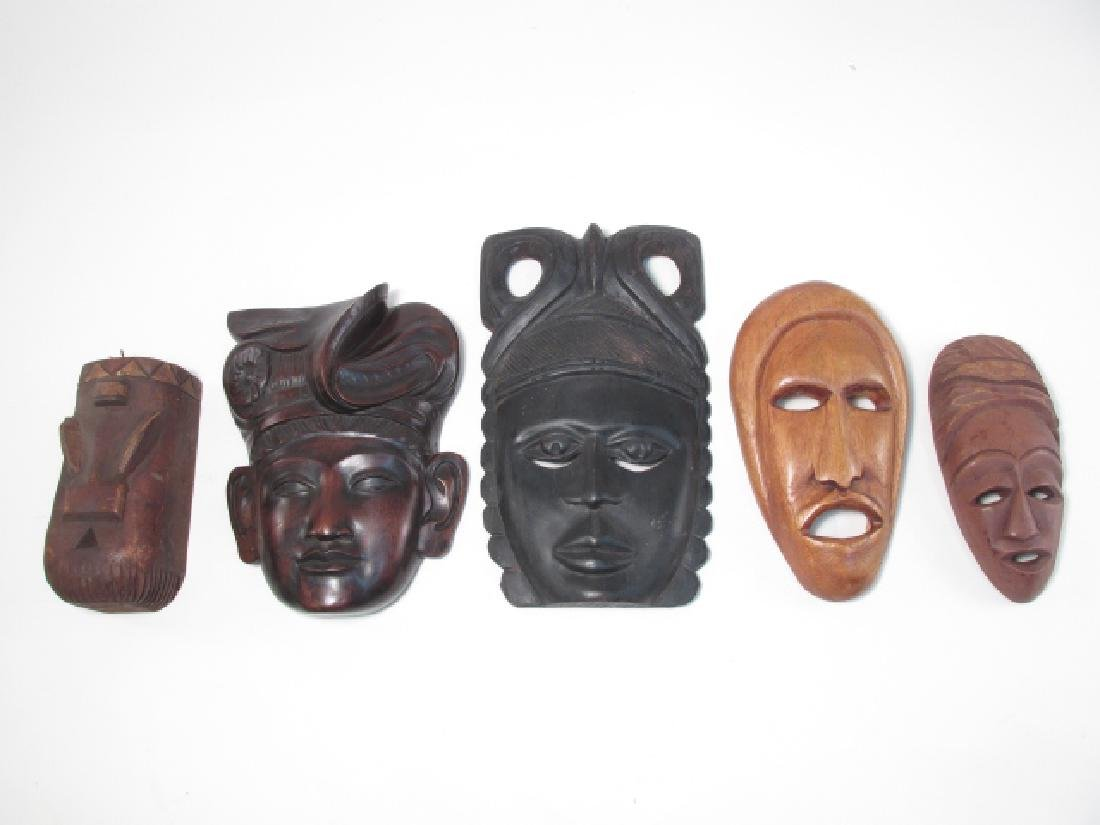 FIVE TRIBAL STYLE CARVED WOOD MASKS