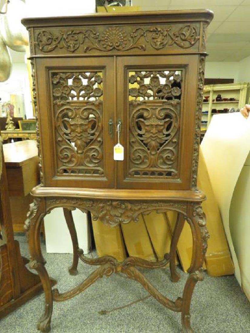 LATE 19TH/ EARLY 20TH C CARVED WALNUT CABINET