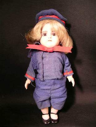 SMALL GERMAN PORCELAIN DOLL