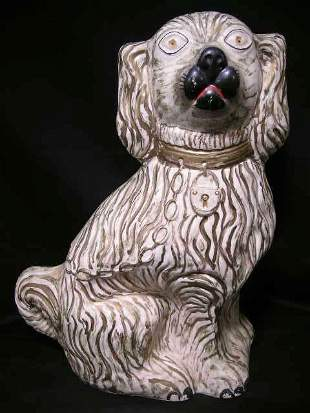 ANTIQUE STAFFORDSHIRE PORCELAIN DOG FIGURINE