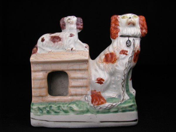 401: ANTIQUE STAFFORDSHIRE POTTERY SPANIEL DOGS