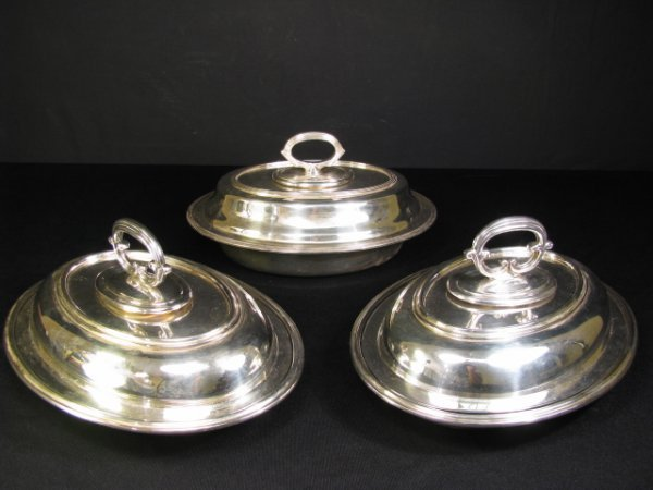714: THREE SILVER PLATE OVAL COVERED SERVING BOWLS