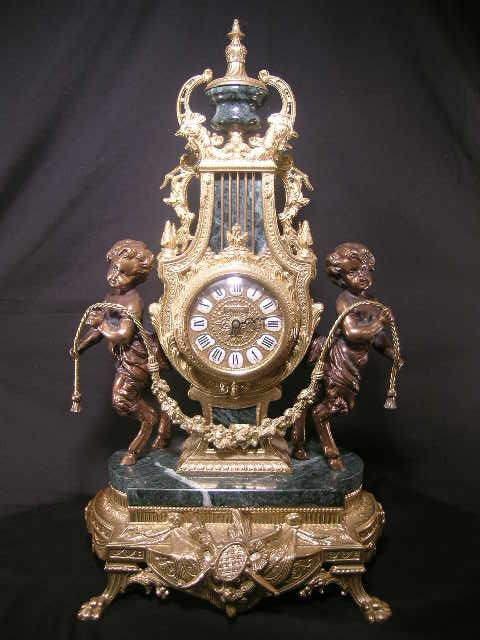 14: IMPERIAL BRASS MARBLE CHERUB DECORATED CLOCK
