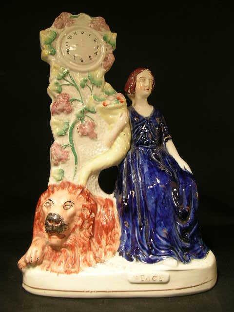 166: ANTIQUE STAFFORDSHIRE PORCELAIN WOMAN LION CLOCK P