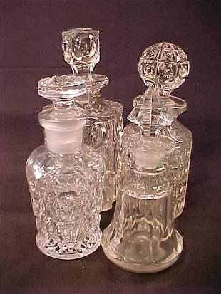 ASST'D ANTIQUE GLASS DECANTERS 4 pc