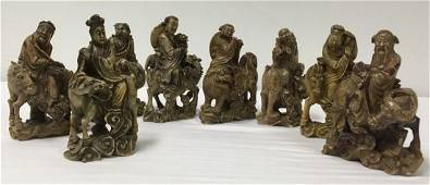 EIGHT CHINESE QING DYNASTY CARVED STONE IMMORTALS