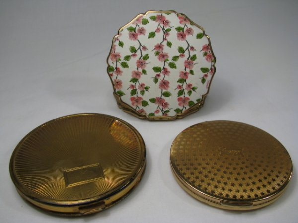 607: THREE GOLD TONE METAL COMPACTS STRATTON, HUDNUT