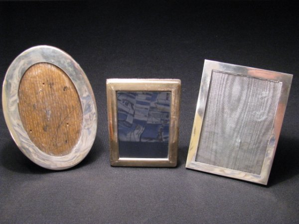610: THREE SMALL STERLING SILVER FRAMES