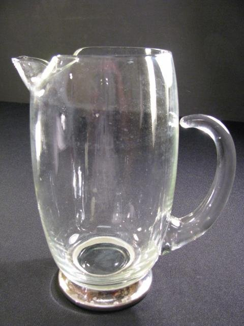 612: CLEAR HAND BLOWN PITCHER W/SILVER PLATE BASE