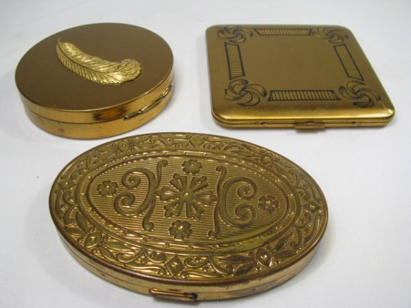 621: THREE GOLD TONE METAL COMPACTS ELGIN DORSET FEATHE