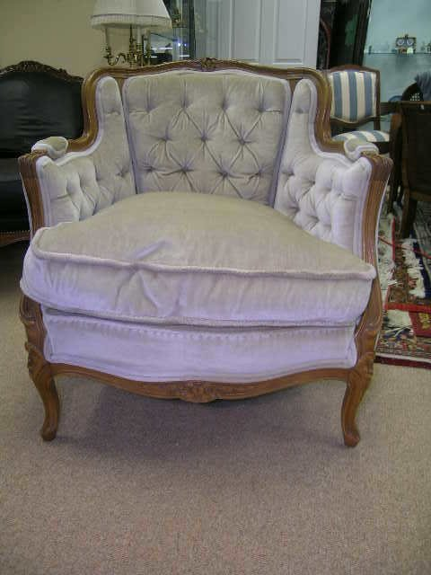 18: UPHOLSTERED BEIGE BERGERE CHAIR