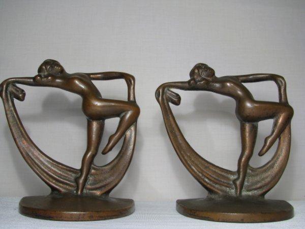 23: PAIR ART DECO BOOKENDS FEMALE DANCING NUDE CAST IRO