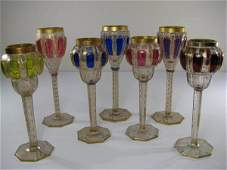 SEVEN BOHEMIAN GILT DECORATED RHINE WINE STEMS