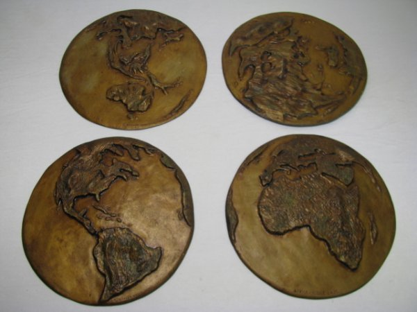 2: FOUR BRONZE FINISH PLAQUES OF CONTINENTS